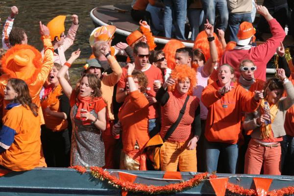 Orange crowd on a boat in the Prinsengracht | Queens Day | Netherlands