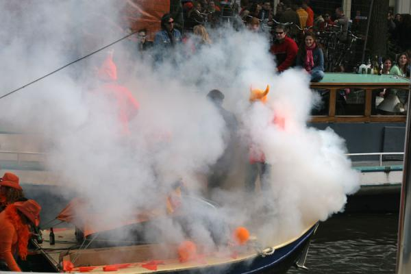 Foggy boat on the canals of Amsterdam during Queen's Day | Queens Day | Netherlands