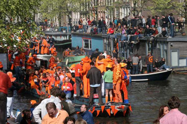 Picture of Orange boat in the canals of Amsterdam during Queen's Day
