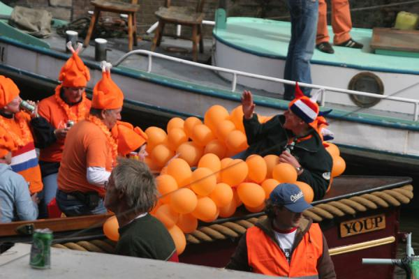 Orange comes in many forms, also balloons on this boat | Queens Day | Netherlands