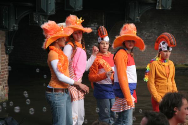 Orange hats on a boat in Amsterdam during Queen's Day | Queens Day | Netherlands