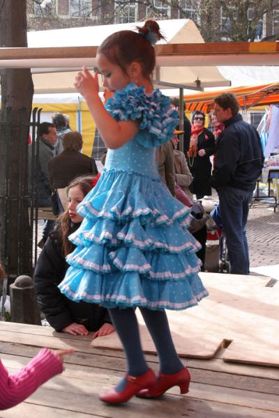 Young girl dancing in the street for Queen's Day | Queens Day | Netherlands