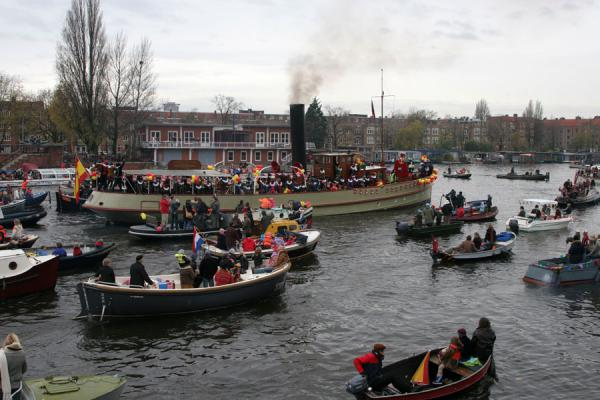 Picture of Sinterklaas on his steamboat, entering Amsterdam in November