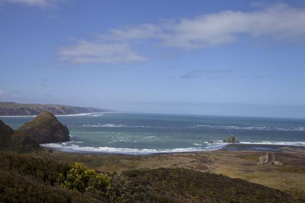 Picture of Looking out over Cutter Rock, Ninepin Rock, and the coastline and wetlands at Whatipu - New Zealand - Oceania