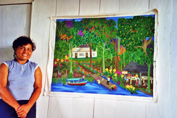 Picture of Paintress proud of her own workSolentiname - Nicaragua