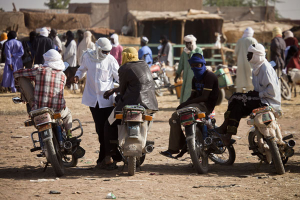 Motorbike drivers waiting for customers at the cattle market of Agadez | Marché de bétail de Agadez | Niger