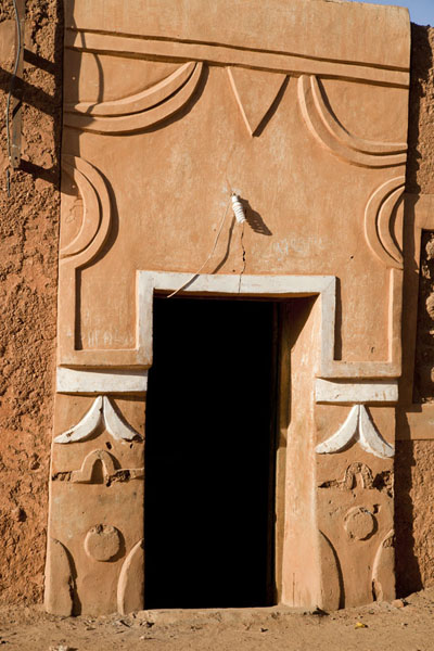 Decorated door in an adobe house in the old town of Agadez | Agadez Old Town | Niger