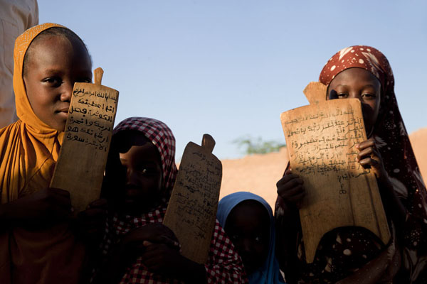 Picture of Zinder Old Town (Niger): Girls showing their prayer boards with Koranic verses