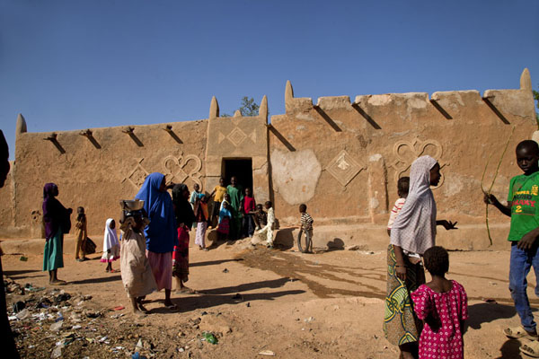 Picture of Zinder Old Town (Niger): Kids in a street in front of a traditional Hausa house in the old town of Zinder
