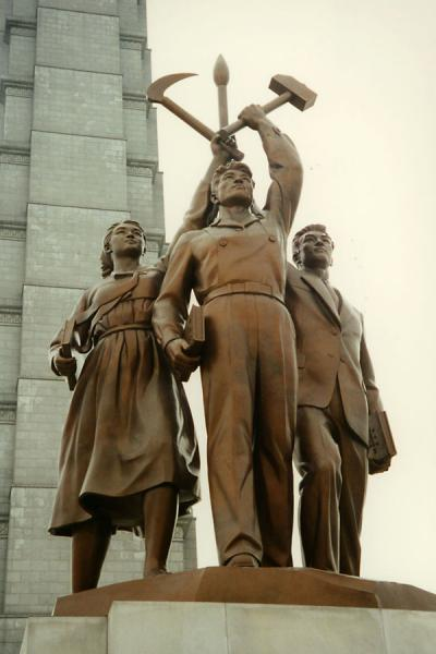 Statue for workers with hammer, sickle, and paintbrush at the Juche monument in Pyongyang | Pyongyang Monuments | North Korea