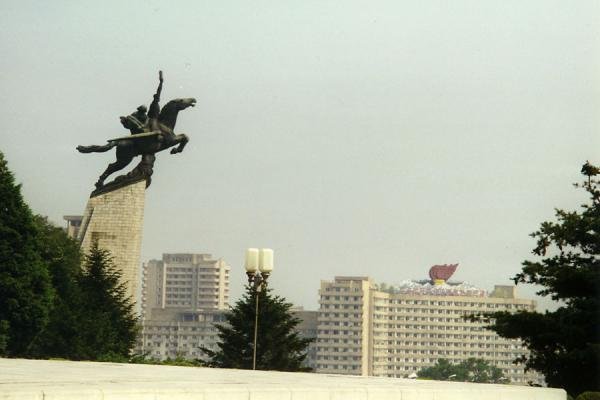 Picture of One of the many statues in Pyongyang and large symbol on a modern building in PyongyangNorth Korea - North Korea