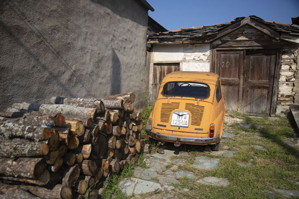 Picture of Corner in Kruševo with firewood and Zastava car