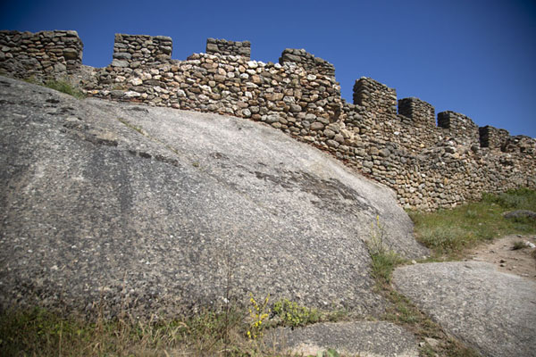Crenelated wall atop the rocks of Marko's towers | Marko's towers | North Macedonia