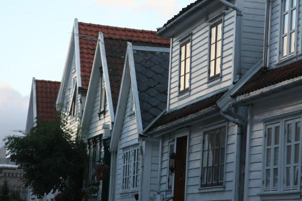 Row of houses catching the last rays of sunlight of the day | Old Stavanger | Norway