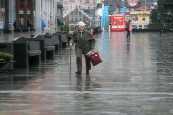 This woman must have seen lots of rain in her life | Rainy Bergen | Norway