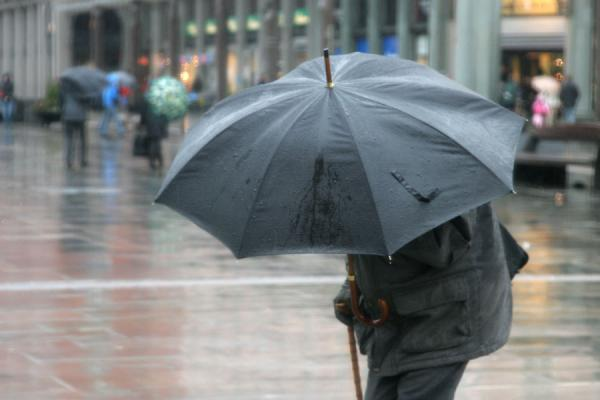 Man sheltering from the rain | Rainy Bergen | Norway