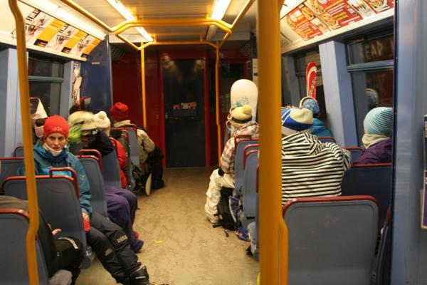Skiers, snow-boarders and cross country skiers in the train back to Oslo | Tryvann skiing | Norway