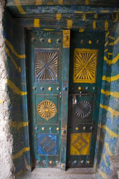 Picture of Painted door in one of the old houses of the mountain village of Bilad Sayt