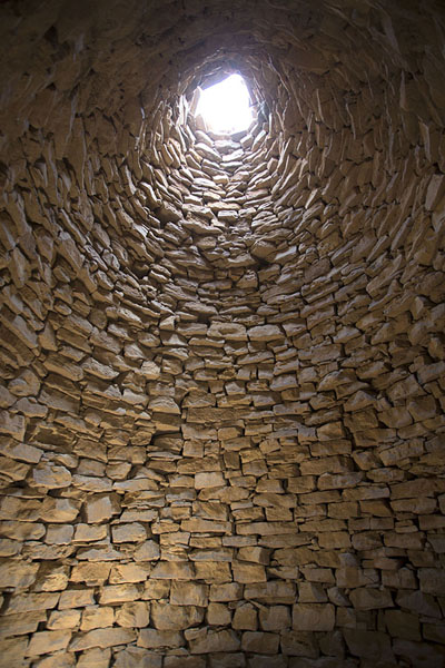Looking up the interior of one of the beehive tombs | Jaylah beehive tombs | Oman