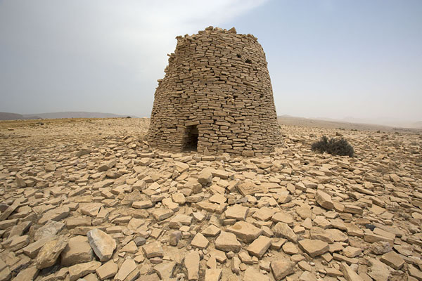 Picture of Partly collapsed beehive tombs surrounded by stones - Oman - Asia