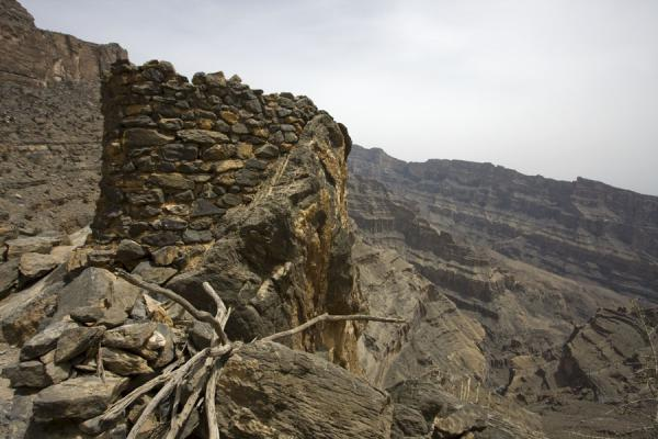 Old stone tower at Sap Bani Khamis | Jebel Shams Grand Canyon | Oman