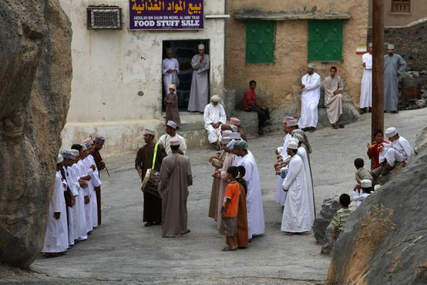 Picture of Misfat (Oman): Men celebrating Eid on a rocky square in Misfat