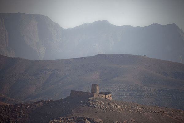 The small Bukha fort dwarfed by the mountains of Musandam peninsula | Musandam Coastline | Oman