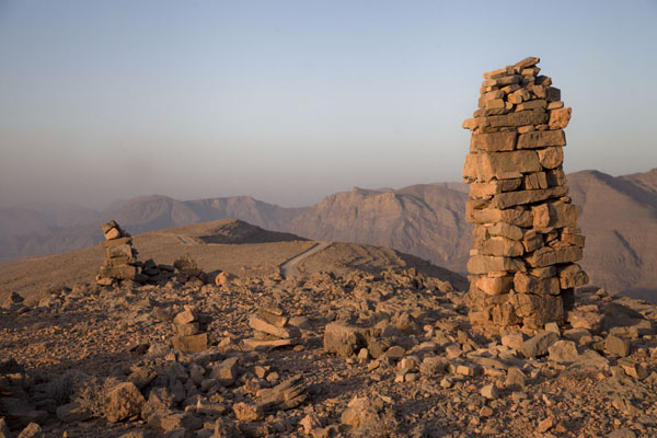 Pile of stones and mountains in the early morning, south of Jebel Harim | Musandam mountains | Oman