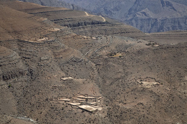Foto di Mountains south of Jebel Harim with settlements carved outMusandam Peninsula - Oman