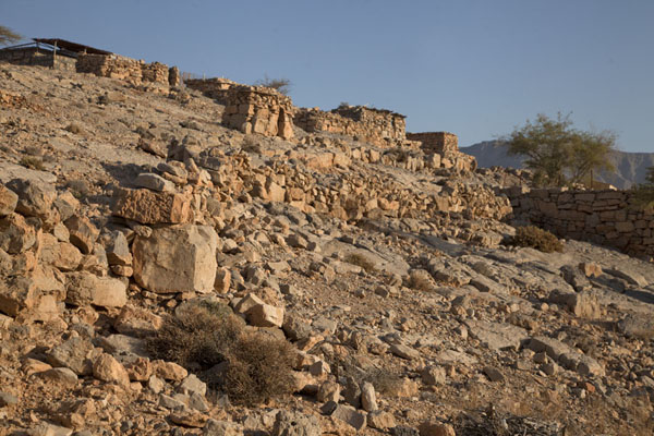 Foto van Stone settlement on a mountain just after sunriseMusandam Peninsula - Oman