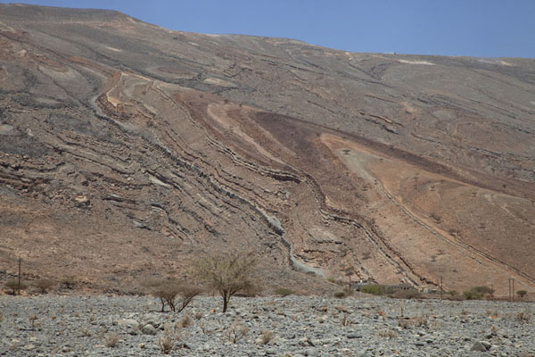 Layered striated rocks in Wadi Bih | Musandam mountains | Oman