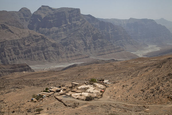 One of the small settlements perched on the rocky mountainside at the feet of Jebel Harim | Musandam mountains | Oman