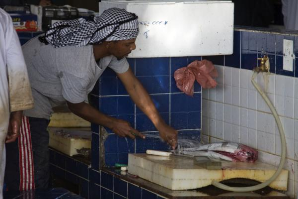 Cleaning and cutting fish | Mutrah Fish Suq | Oman