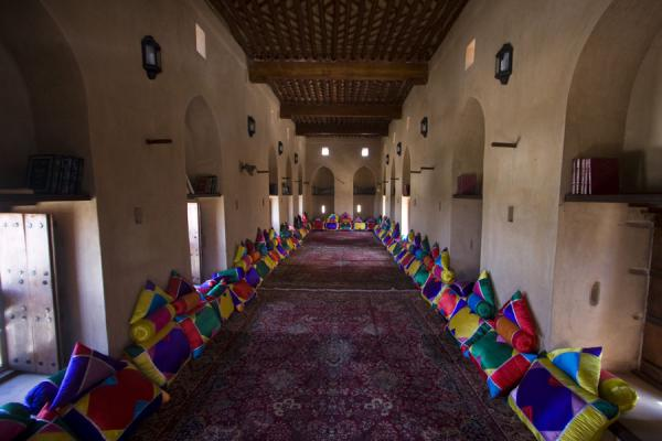 Picture of Nakhal Fort (Oman): A well-ventilated room of Nakhal Fort with carpets and pillows