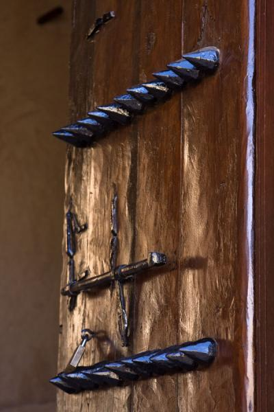 Detail of one of the ancient doors with spikes | Nakhal Fort | Oman