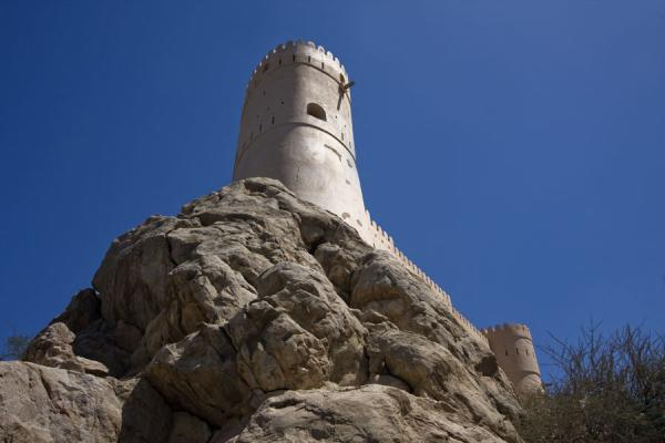 One of the defensive towers of Nakhal Fort seen from below | Nakhal Fort | Oman