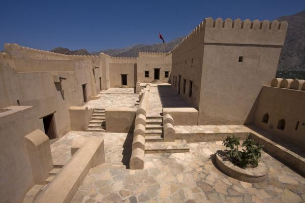 Upper part of Nakhal Fort with crenelated towers, stairs, and rooms | Nakhal Fort | Oman