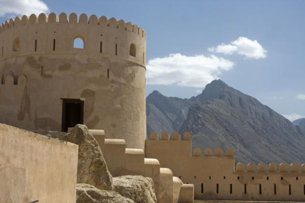 Picture of Nakhal Fort (Oman): Defensive tower on top of Nakhal Fort with mountain in the background