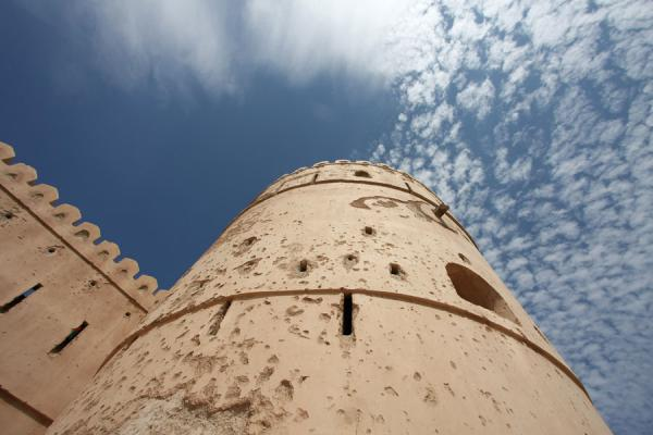 Picture of Qurayat (Oman): Looking up a tower of Qurayat Castle