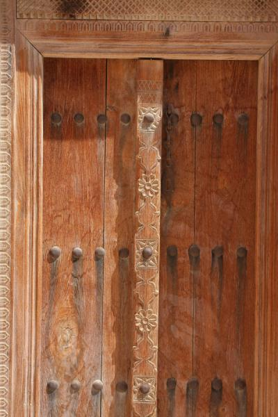 Picture of Qurayat (Oman): Detail of finely carved wooden door in Qurayat Castle