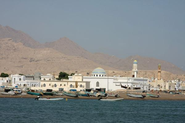 Fishing boats and the main mosque of Qurayat | Qurayat | Oman