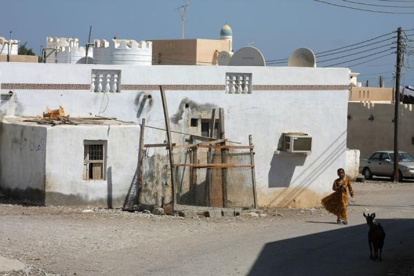 Picture of Qurayat (Oman): Street in Qurayat with Omani girl