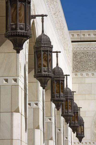 Row of lanterns outside a wall of the Grand Mosque | Sultan Qaboos Grand Mosque | Oman