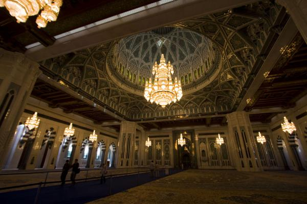 Picture of Sultan Qaboos Grand Mosque (Oman): Main prayer hall with carpet, chandeliers, and huge pillars