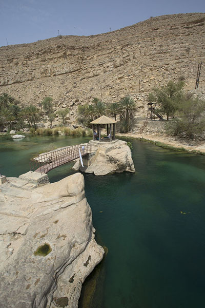 Small shelter on rocky islet inside the pool in the wadi | Wadi Bani Khalid | Oman
