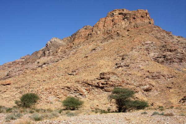 Mountain towering above Wadi Mayh | Wadi Mayh | Oman