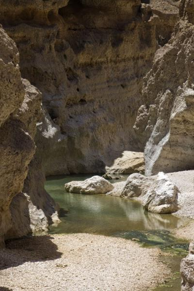 Water running through the rocky cliffs of Wadi Shab | Wadi Shab | Oman