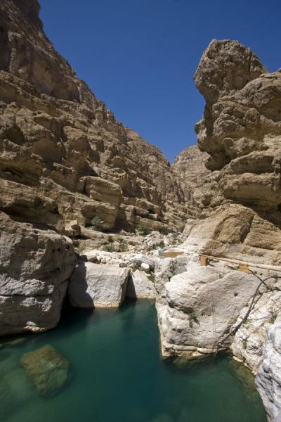 Picture of Wadi Shab (Oman): Deep pool surrounded by rocks in Wadi Shab