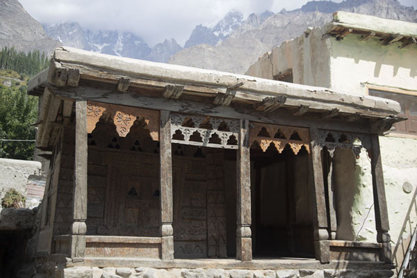 Wooden mosque with snow-capped mountains in the background | Ganish old town | Pakistan