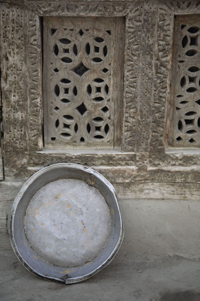 Decorated wooden panel of old house in Ganish with metal tray | Ganish old town | Pakistan